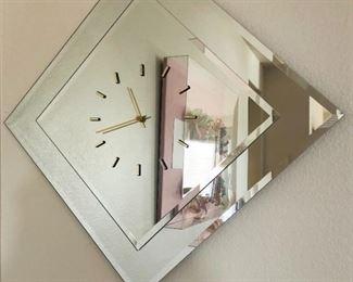 Unique mirrored wall clock