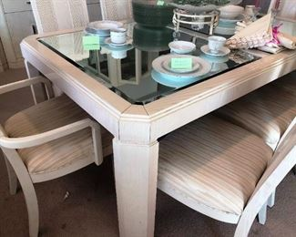 Dining set has 8 chairs, beveled mirror top
