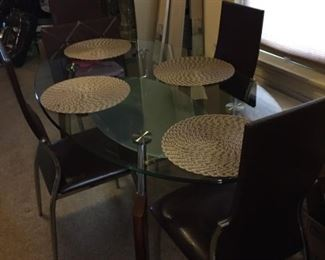 Glass oval dining table 4 chairs.