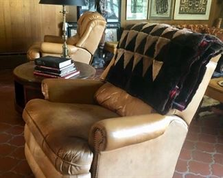Pair saddle colored leather club chairs with nailhead detail