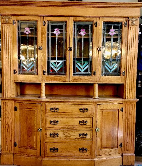 1900's Arts and Crafts two part buffet. Four stained glass panels. Solid oak. $2,200