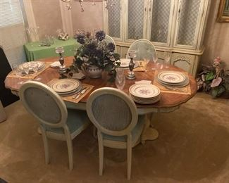 Dining table with chairs and matching china hutch.