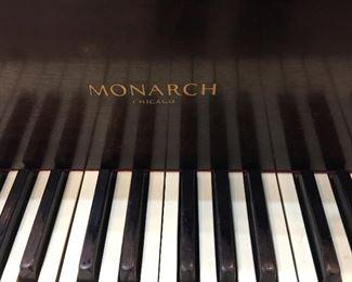 Vintage Monarch 5' baby grand piano.