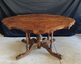 Italian hand carved table in walnut and briar wood, scalloped apron, carved pedestal and carved supports, c. 1860