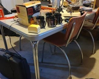 50's chrome table with 4 chairs