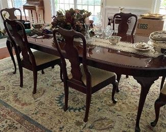 "BEAUTIFUL HENREDON DINING ROOM TABLE IS 64"" LONG AND HAS 2-20"" LEAVES-EXTENDS TO 108"" AND HAS 6 CHAIRS AND ALL PADS"