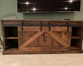 BARN DOOR MEDIA CABINET(BEST BUY) 2 YRS OLD OUR PRICE IS MUCH LESS