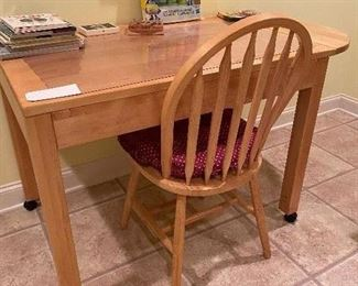 THE TABLE IS SOLID MAPLE WITH DROP LEAF ON 1 SIDE