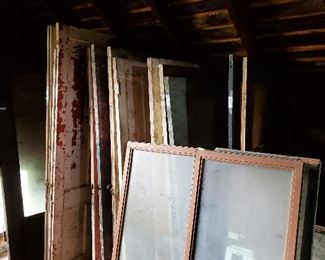 Old Vintage Doors and Window Sashes with knobs and hardware on most.