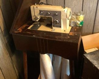 sewing machine pounding its head against the wall