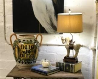 Antique window railing upcycled into table, huge heron print, equestrian lamp and large olive jar