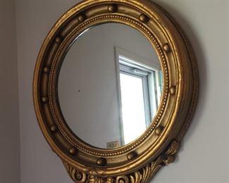 Beautiful Oval gilded mirror.