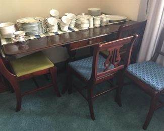 """Duncan Phyfe Table and four chairs plus beautiful set of """"Bell Flower"""" China."""
