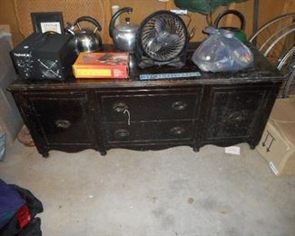 Antique sideboard with legs cut off for use as coffee table