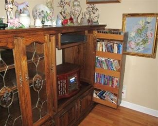 Dark Oak Cabinet that would make an excellent bookcase, storage area.. with LARGE flat TV on top.. pull out for tapes,  This home is FULL of GREAT items...