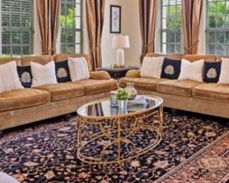 Exquisite black, gold, cream and rust hand-knotted wool rug make in Pakistan retail $5000 selling for $1500; custom fabric Bernhardt sofas Retail $3000 selling both for $1000, solid wood side tables - retail $650 each, selling for $200 each.