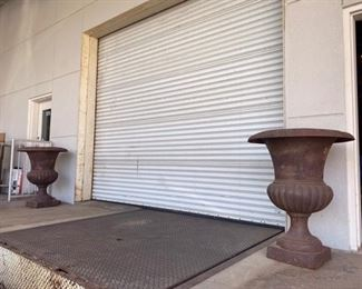 - $1200 massive pair of a French iron urns