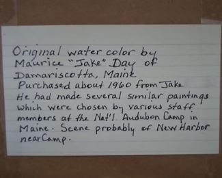 """Hand written card attached to the back of the Watercolor by Maurice """"Jake"""" Day painting. It contains the provenance as written by Mary Jane Dockeray."""