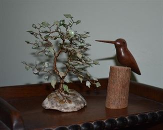 1) Hand made tree with Jade leaves and a Copper Body Tree on a fossilized coral Stone  2) Hand carved Humming Bird perched on a piece of wood