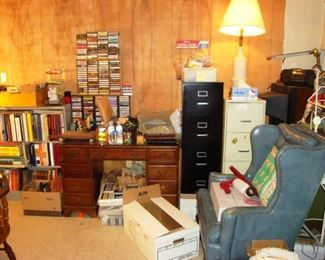 Desk, file cabinets, wing back chair, music cassettes