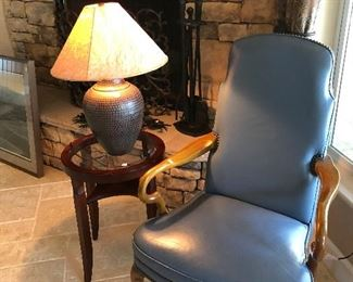 leather armchair - copper hammered lamp