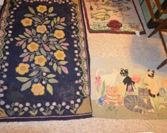selection of hand made hooked rugs