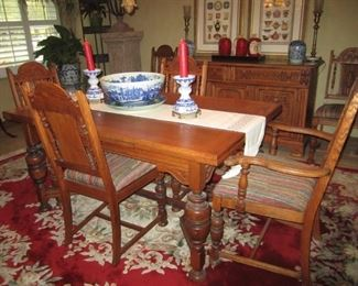 ANTIQUE OAK TABLE WITH END PULL OUTS AND 6 CHAIRS