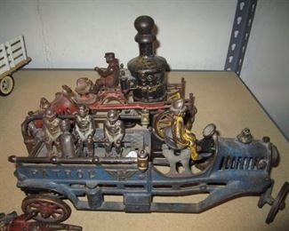 CAST IRON FIRE TRUCK AND MEN