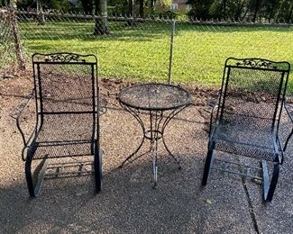 cantilever wrought iron pair of chairs and separate table