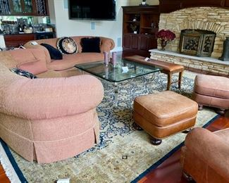 """Lot 3175. $650.00 C.R. Laine in Hickory, N.C. Kidney Shaped Sofa was $2000 new! In a heathered rust color. 92""""w 48""""d x 35""""t 18"""" seat height Lot 3176. $650.00  C.R. Laine in Hickory, N.C. Kidney Shaped Sofa was $2000 new! In a heathered rust color. 92""""w 48""""d x 35""""t 18"""" seat height Lot 3177.$475.00  Glass Coffee Table w/bevelled glass 48"""" x 48"""" x 20"""" high Lot 3178. $625.00 Black Marble Round End Table Interesting Imported from Italy (originally $1186)32"""" round x 30"""" high"""