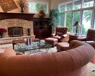 """Lot 3175. $650.00 C.R. Laine in Hickory, N.C. Kidney Shaped Sofa was $2000 new! In a heathered rust color. 92""""w 48""""d x 35""""t 18"""" seat height.  Fore Ground                                            Lot 3177.  $475.00  Glass Coffee Table w/bevelled glass48"""" x 48"""" x 20"""" high                                                                                          Lot 3182. $650.00 Classic Leather Chair and Ottoman nailhead trim detail. Was $1950 new! Medium Brown: chair: 40""""H to back x 29""""D x 39""""W  seat: 19""""H  x 20""""W x 22""""Deep; Ottoman: 22""""W x 21""""L x 17""""H Lot 3183 $650.00  Classic Leather Chair and Ottoman nailhead trim detail. Was $1950 new! Medium Brown: chair: 40""""H to back x 29""""D x 39""""W  seat: 19""""H  x 20""""W x 22""""Deep; Ottoman: 22""""W x 21""""L x 17""""H"""
