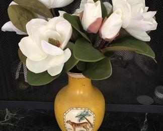 Yellow vase with jungle scene.