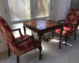 Chess table with chess set and matching armchairs.