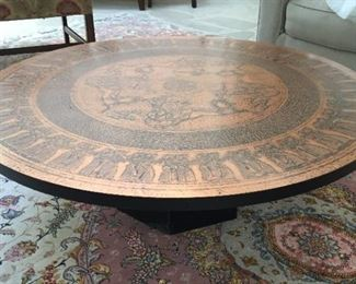 Low brass topped table.