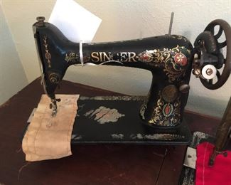We have two of these Singer Sewing Machines, this one is dated 1922