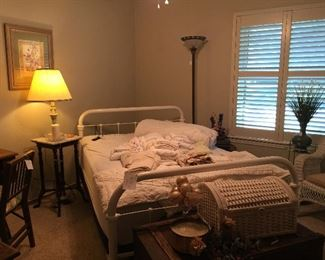 This is the guest room and it has a wonderful antique white painted full bed.  The bed has a new adjustable mattress.  Antique trunk, wicker trunk, wicker furniture and accent tables.