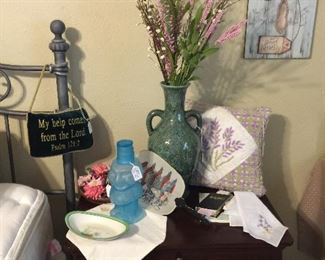We have two of these bedside tables with lots of storage, lots and lots of vintage hankies, floral, interesting water container.