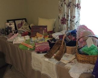 Bathroom linens and accessories, table linens, towels, vintage scarves, we have lots of doilies.