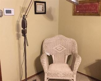 Vintage wicker chair, upholstered foot stool, vintage lamp, art work