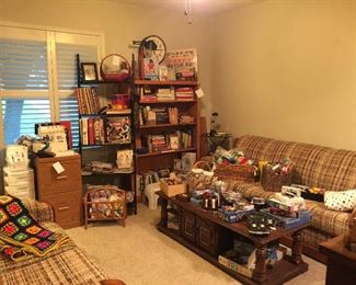 This bedroom contains, books, games, vintage furniture, sewing items and office supplies
