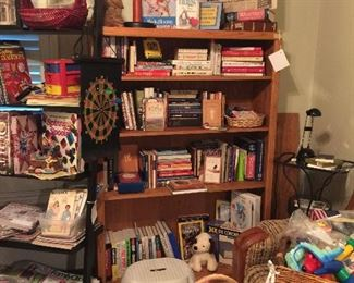 Lots of great books, owls, very nice desk lamps, sewing books and craft items