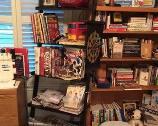Black shelf and an oak book shelf, sewing books and magazines also cooking