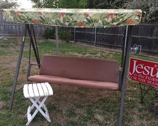 A second swing with canopy and cushion