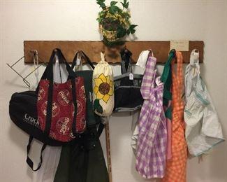 Lots of vintage aprons, crock pot bags
