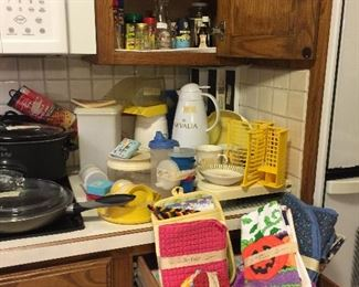 Lots of vintage Tupperware, kitchen linens, coffee items