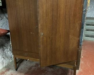 Danish modern cabinet. It does need some TLC: it has missing trim pieces on the bottom right drawer. The shelves inside are adjustable. It locks, and the key is present! $195