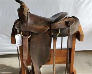 "219	  Macpherson Western Roping Saddle Vintage 15""  Macpherson Western Roping Saddle Los Angeles, Ca.  A fork swells.  Has complete rigging.  Ready to go to work tomorrow.  Has makers marks."