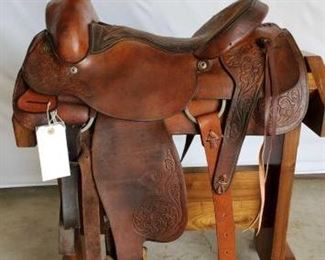 "228	  Hereford Brand Roping Saddle 16"" Hereford Brand Tex Tan of Yoakum Roping Saddle. Has makers mark. In working condition  Missing one blevins stirrup clip.  Serial # 5100 Front and back cinches."