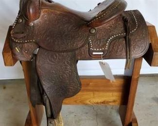 "230	  Western Roping Saddle 15"" Western Roping Saddle with white buck stitching.  Breast collar and front cinch. Seat needs minor repair, see photos, otherwise in working condition."