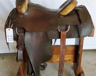 "221	  Simco Western Roping Saddle 15 1/2"" Simco Western Roping Saddle #4958.  Rawhide Cantle and swells.  Has front and back cinch. In good working order.  Has makers mark."